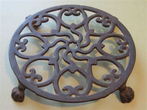 antique primitive cast iron round footed trivet
