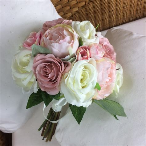 A Brides Bouquet Of Pale Pink And Ivory Silk Roses And Peony