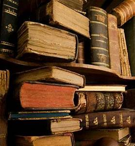 Old books stuffed into shelves...