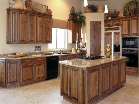 how to change a kitchen sink faucet how to stain oak kitchen cabinets plus staining cabinets