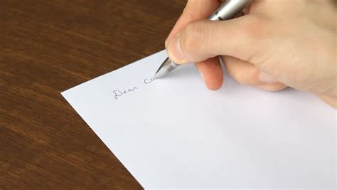 man writing stock footage video  shutterstock
