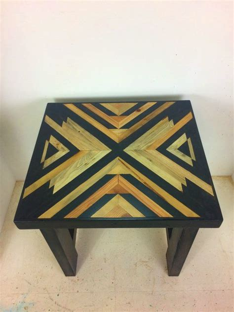 this table has a geometric pattern design top made from