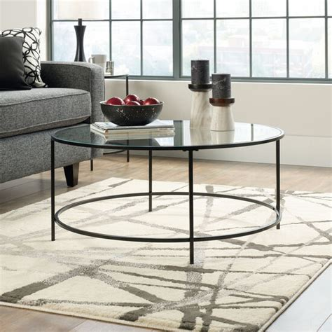 Coffee tables have a prominent place and function in a living room. Round Contemporary Coffee Table in Black   Mathis Brothers ...