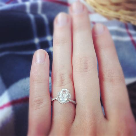 awesome engagement ring oval stone no diamonds around the center stone and split prong rose