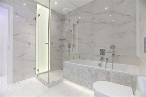 Carrara Marble Bathroom Floor by Wood Floors White Cabinets Bathrooms With