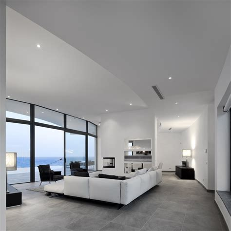 Grey Tiles Living Room by Modern Cliff View Mansion Colunata By Mario Martins In
