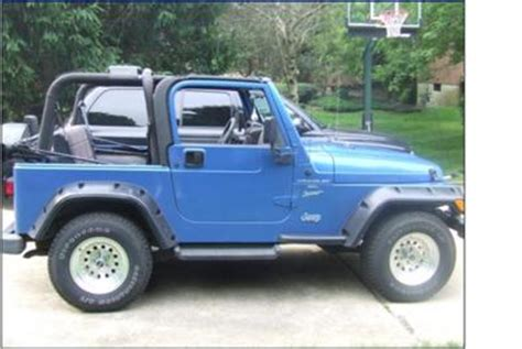 jeep blue and black black and blue my first jeep its a 1999 tj