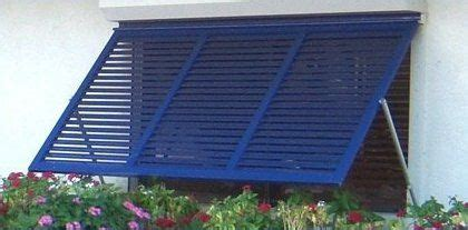 slatted metal awning  front picture window   privacy