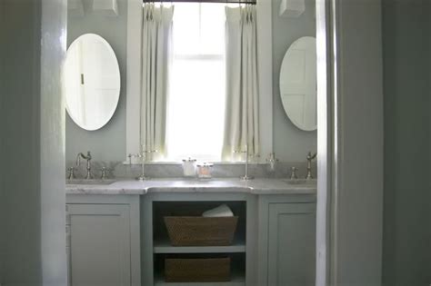 cottage kitchen hutch the window with mirrors on either side a vanity and 2651
