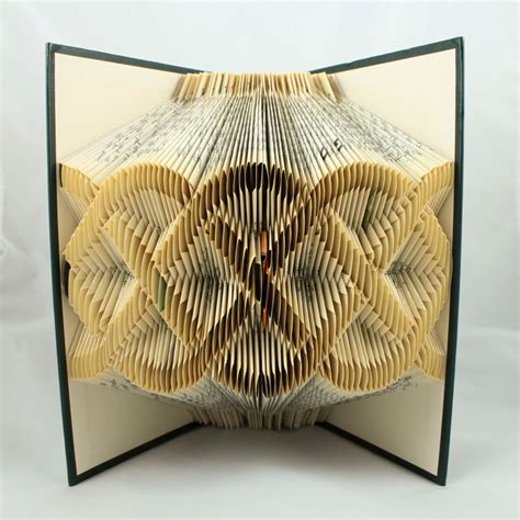 Beautiful Folded Book Art Featuring Words And Patterns