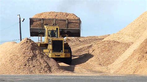 front  loader working scooping wood chips youtube