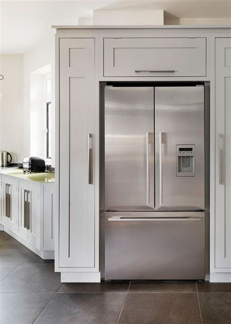 Many kitchen appliances including refrigerators, dishwashers, ovens, and other appliances are often integrated. love the cabinets around the fridge | Kitchen refrigerator ...