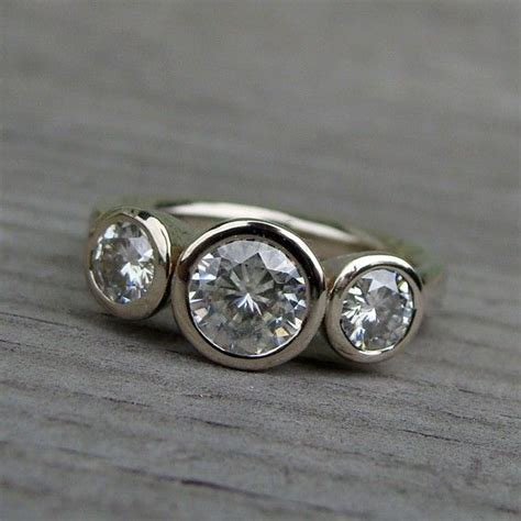 moissanite and recycled 14k white gold three wedding or engagement ring made to order