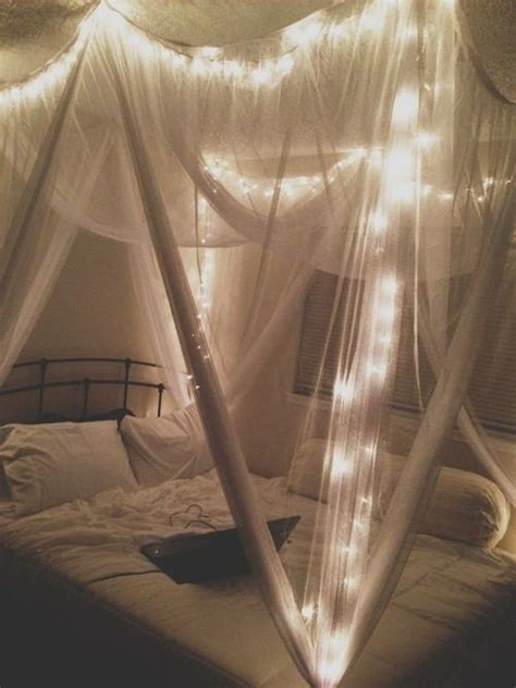 draping curtains bed with sparkling lights interior