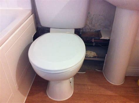Box work around pipes under toilet/sink approx 70cm