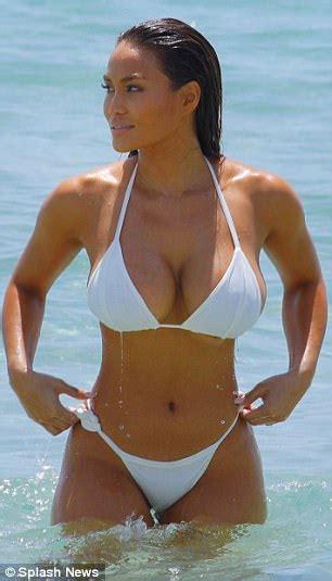 Daphne Joy stuns in wet white bikini on Miami beach ...