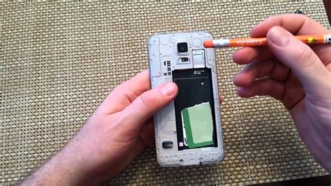 samsung galaxy s5 remove install back cover battery sim card sd memory card replace insert