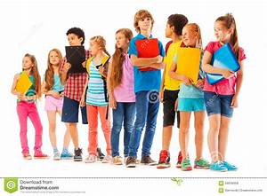 School Kids Standing In The Line With Books Stock Image ...