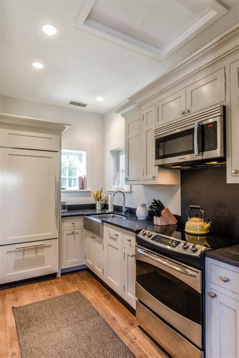 cottage kitchen  white cabinets  dark countertops