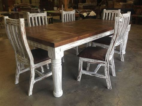 rustic diningkitchen table   tooled leather chairs