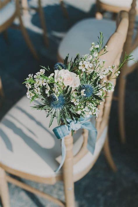 wedding chair bouquets tied  powder blue velvet ribbon