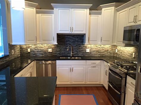 White Cabinets With Granite by Uba Tuba Granite Countertops Pictures Cost Pros Cons