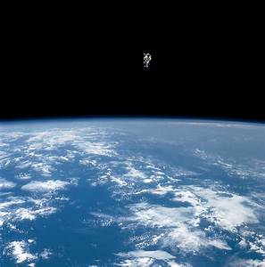 An Astronaut Propelled Above The Earth Photograph by Nasa