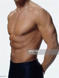 Man Showing Welldefined Chest Abdominal And Arm Muscles