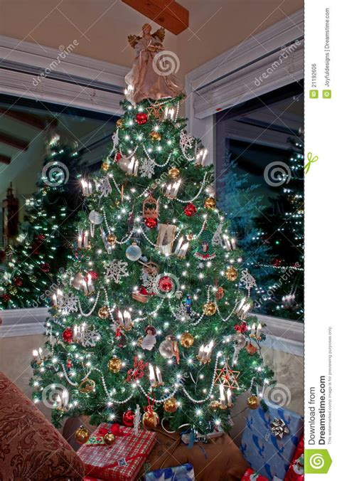 vertical tall decorated christmas tree indoors stock photo