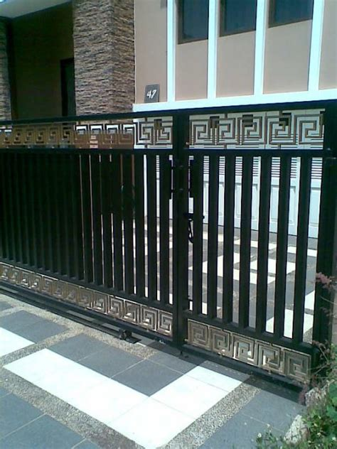 teralis minimalis pintu pagar besi
