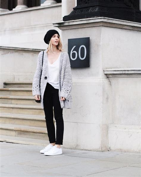 A White Shirt, A Gray Sweater, Black Pants, And White