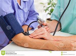 Doctor Taking Pulse Royalty Free Stock Photos