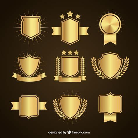 set de elegantes escudos dorados descargar vectores gratis
