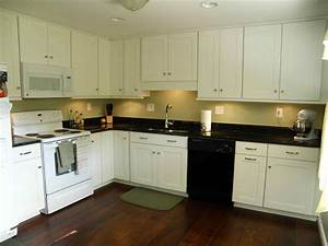 Black countertops white cabinets blue walls deductourcom for Kitchen colors with white cabinets with wall art stone