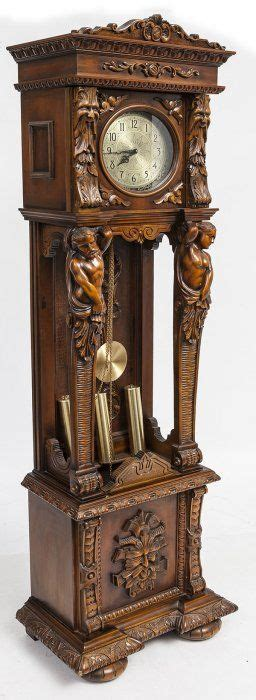 ornate carved tall case clock  carved figures zegary