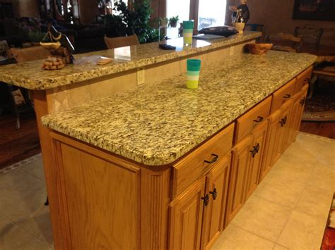 raised kitchen sink island with raised seating area surface facing the living 1715