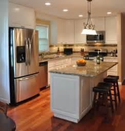 Remodeling Kitchen Island Kitchen Remodel White Cabinets Tile Backsplash Undercabinet Lighting Island Traditional