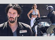 Keanu Reeves chats up brunette while astride motorbike