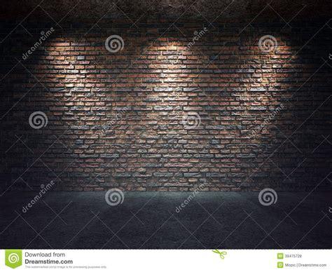 brick wall illuminated  spotlights stock photo
