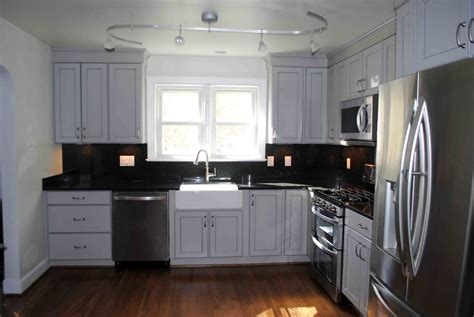 grey kitchen cabinets with black appliances pet friendly home designs hatchett design remodel 8358