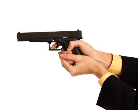 pistol  stock photo  hand   business suit holding  pistol