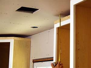 How to install kitchen cabinet crown molding how tos diy for How to install crown molding on kitchen cabinets