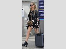 Laura Whitmore's tiny floral dress accidentally exposes