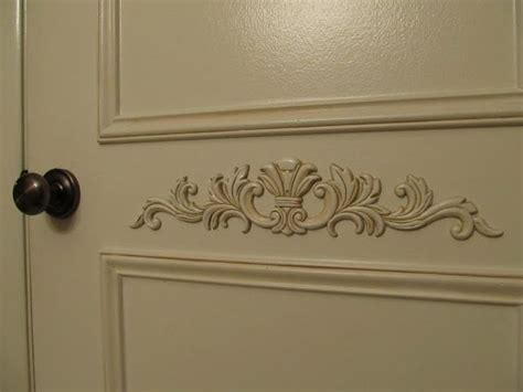 Pantry doors, raised panel, antiqued, wooden appliques