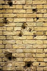 Bullet holes in the brick wall | Stock Photo | Colourbox