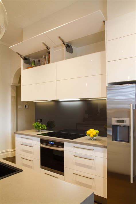 modern kitchen overhead cabinets modern galley style kitchen lift up overhead cupboards by