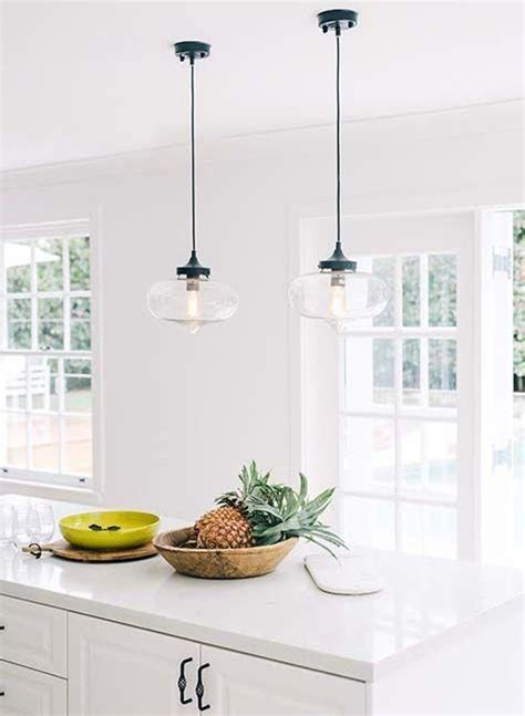 industrial hanging pendant lights   white granite composite counter   kitchen island