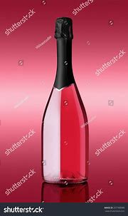 Bottle Of Sparkling Wine On Pink Background Stock Photo ...
