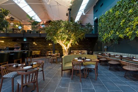 modern kitchen interior design images greenery filled restaurant ours opens in s