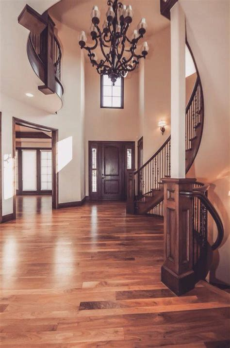 luxury foyer  straight staircase leads    story living room home decor